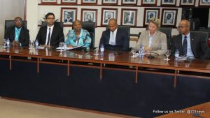 On the left are representatives from the SER, and on the right members of the Council of Ministers, in the Dr. A. C. Wathey Legislative Hall at the Government Administration Building. (DCOMM)