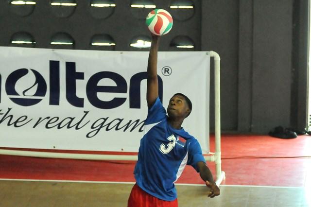 Derrick Tidort of Dutch Saint Marrten serves against Britsh Virgin Islands_ 01