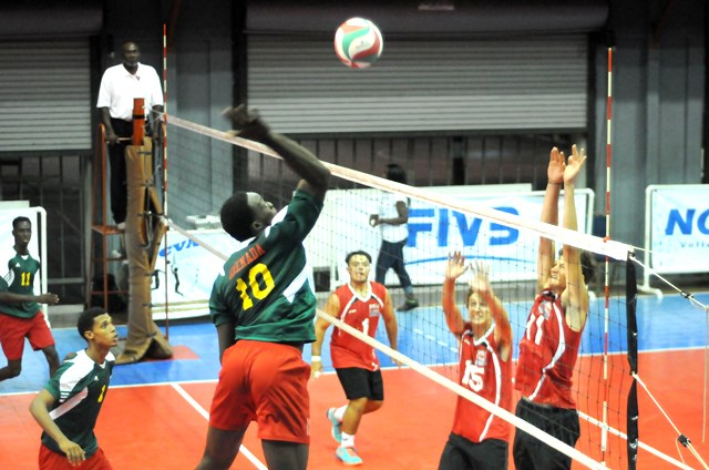 Kevon Noel of Grenada spikes against Bermuda_ 02